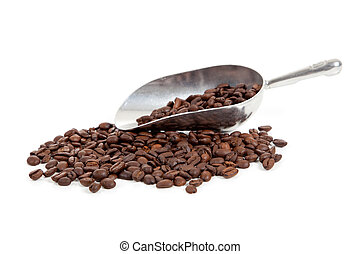 Coffee beans and a silver scoop on white