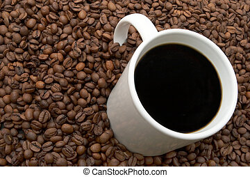 Coffee Beans and Brewed - Cup of coffee in a sea of coffee ...