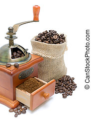 coffee beans and coffee grinder on white background