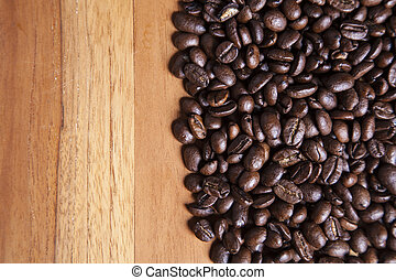 coffee beans and copy space on the wooden table