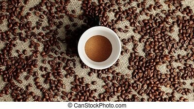 Coffee beans and cup of powder - Flat lay of white cup with...