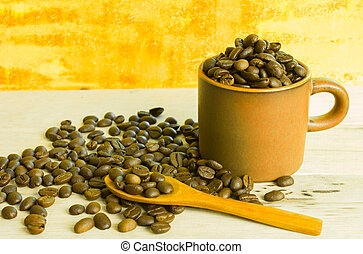coffee beans and cup on the wooden table