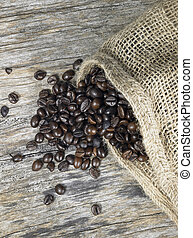 coffee beans and jute bag - coffee beans fallen out of a ...