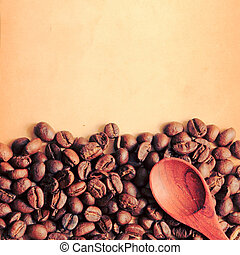 Coffee beans and spoon with old paper, retro filter effect