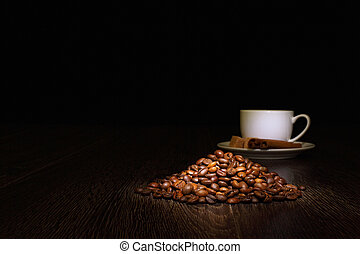 Coffee beans and white cup - Image of coffee beans and white...