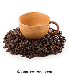 Coffee beans and wooden cup ioslated on a white background