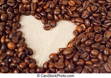 coffee beans arranged in heart shape