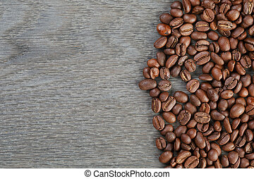 coffee beans border on old oak table