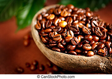 Coffee beans. Bowl of Aromatic Coffee close-up