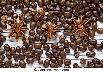 Coffee beans, cinnamon and star anise on white background