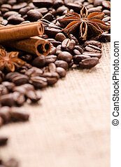 Coffee beans, cinnamon and stars of anise on the table