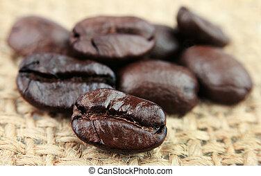coffee beans closeup on linen texture