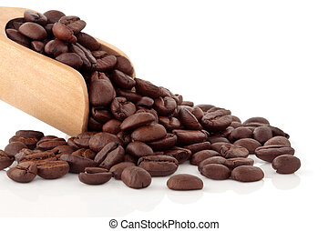 Coffee beans in a wooden scoop and scattered, isolated over white background.