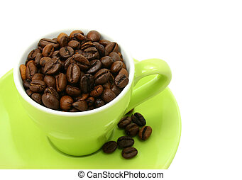 Green cup full of coffee beans (clipping path included)