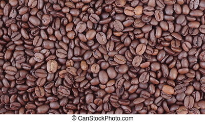 Coffee beans diagonal panning video - Roasted coffee beans...