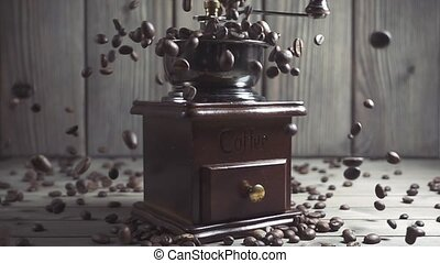 Coffee beans fall in the old grinder. Slow motion