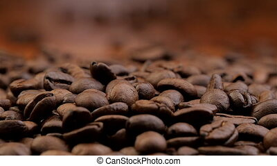 Coffee beans falling down in slow motion
