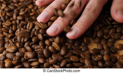 Coffee beans falling in slow motion