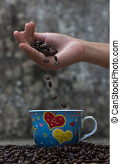 Coffee beans falling in white coffee cup. slow shot