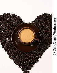 Coffee beans forming a heart. Cup of coffee