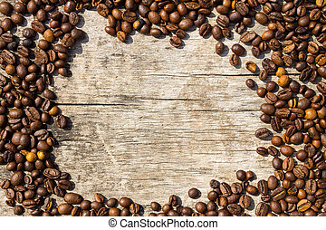 Coffee beans frame on grunge wooden background