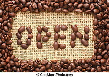 coffee beans frame with open text on sacking