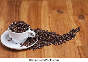 coffee beans in a cup on the wooden table