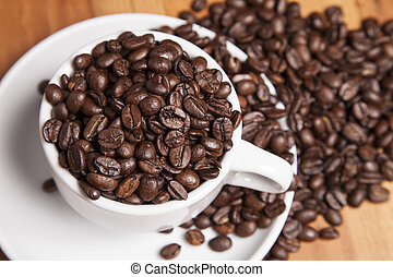 coffee beans in a cup, view from above