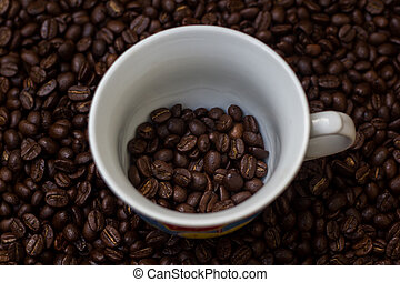Coffee beans in a cup,cup of coffee with beans