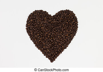 Coffee beans in a form of a heart isolated on white background.
