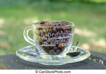 Coffee beans in a transparent coffee cup