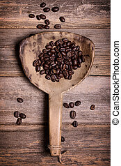 Coffee beans in antique scoop.