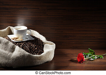 coffee beans in bag with rose