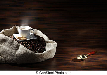 coffee beans in bag with spoon