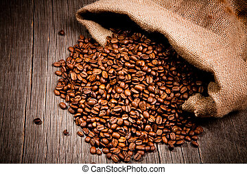 Coffee beans in burlap bag