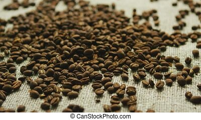 Coffee beans in disorder - Pile of brown coffee beans laid...