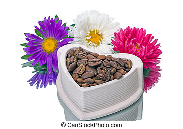 Coffee beans in heart shape box and flowers