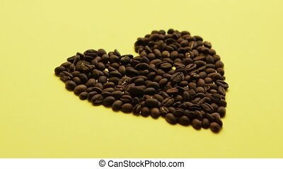 Coffee beans in heart shape - Composition of roasted brown...