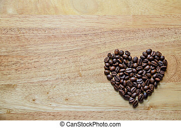 coffee beans in heart shape on wooden panel