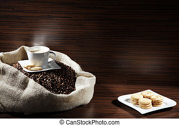 Coffee beans in sack with cookies