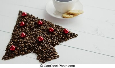 Coffee beans in shape of conifer and cup - From above view...