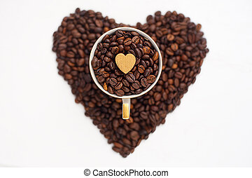 coffee beans in the shape of a hear