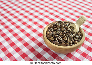 Coffee beans in the wooden bowl