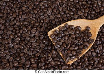 Coffee beans in wood ladle