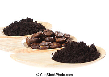 Coffee Beans in wooden spoon isolated on white