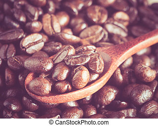 Coffee beans in wooden spoon with filter effect retro vintage style