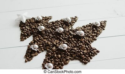 Coffee beans laid in shape of fir - From above view of...