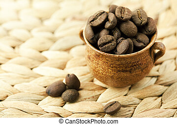 coffee beans lying in a small jug