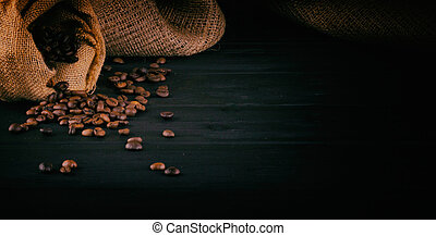 Coffee beans on a dark wooden background with space for your text