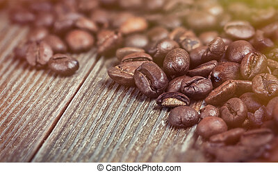 coffee beans on a wooden background in old color